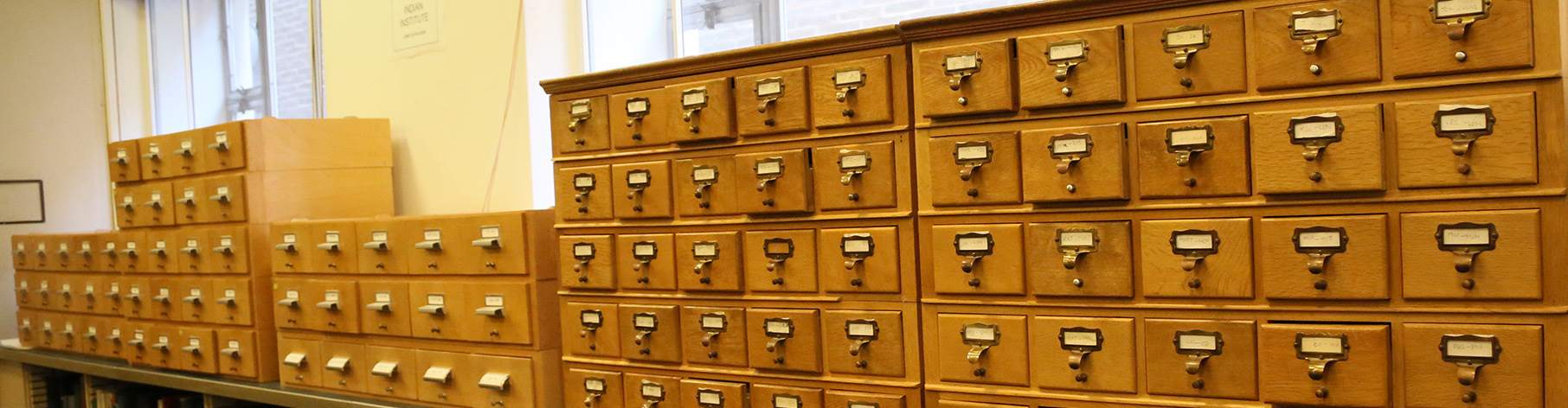 Rows of small wooden drawers containing the card catalogue