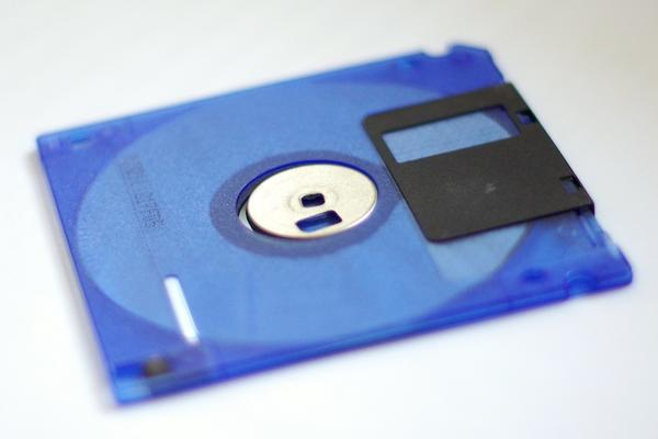 A blue diskette on a white background