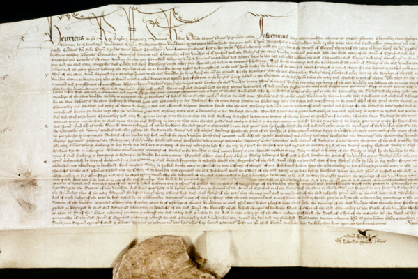 A handwritten scroll with a seal