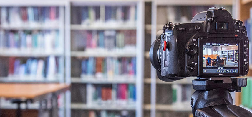 A camera set up to record the inside of a library