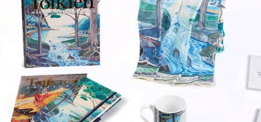 A range of products decorated in Tolkein illustrations: a book, a notepad, a scarf and a mug